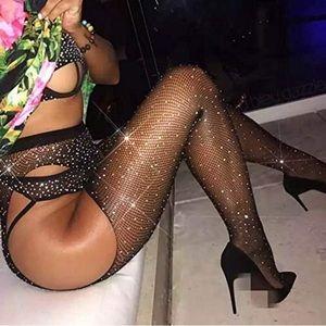 Woman's sparkling black sexy fishnet stockings *
